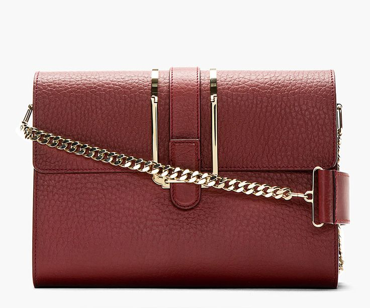 Structured grained calfskin shoulder bag in crimson red. Gold-tone hardware. Curb chain shoulder strap with leather pad. Designed by Chloe. http://www.zocko.com/z/JJ6RN