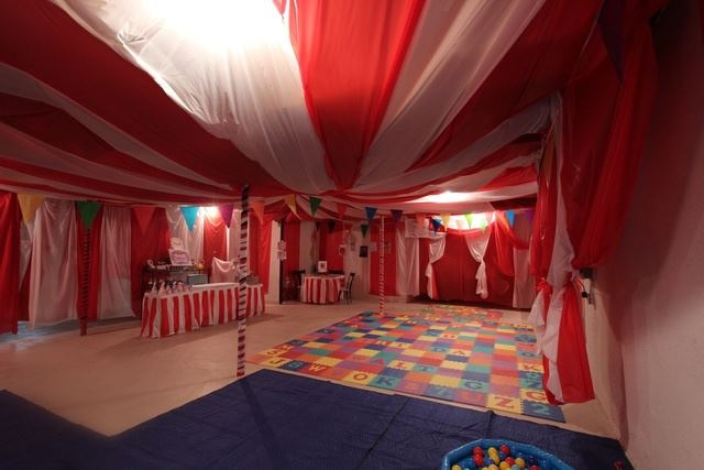 Decorating Ideas > A Circus Tent Built With A Staple Gun Inside An Unfinished  ~ 131212_Basement Party Decorating Ideas
