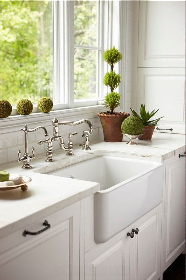 Kitchen Sink. Farmhouse sink. A beautifully integrated farmhouse sink is surrounded by immaculate white marble and flanked by integrated Dishwasher. #Kitchen #Sink #FarmhouseSink