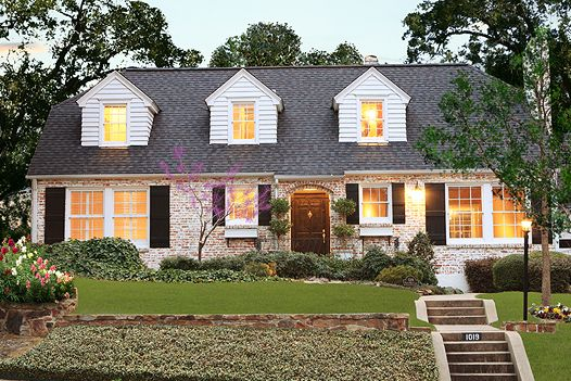 pink brick with cream and black accent colors 10 Most Beautiful Homes in Dallas | D Magazine