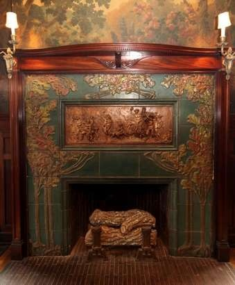 Fred Martens and Warren Liang's Rookwood fireplace. A relief with the signature Clodion is embedded in the fireplace (center), and is not Rookwood.