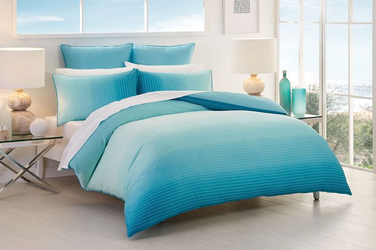 In subtle shades of oceanic blues and greens, this beautiful ombre design is naturally stylish in any setting #bedroom #bedbathntable