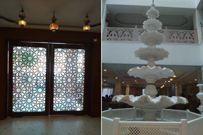 Incredible stained glass door and white marble fountain two stories high in the hotel.