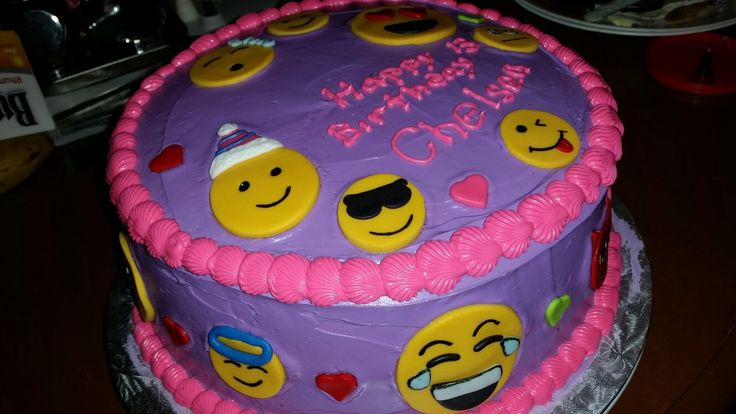Cute emoji theme cake with fondant decorations.