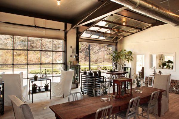 glass garage door room | Sectional glass garage door used in an eclectic living room with ...
