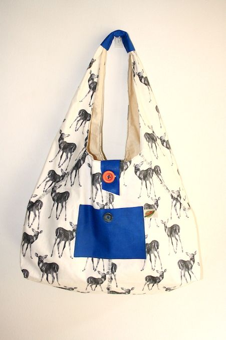 This spacious slouch bag is the perfect shopping accessory. Made of high quality cotton drill with kangaroo leather trimmings. Handmade in Melbourne