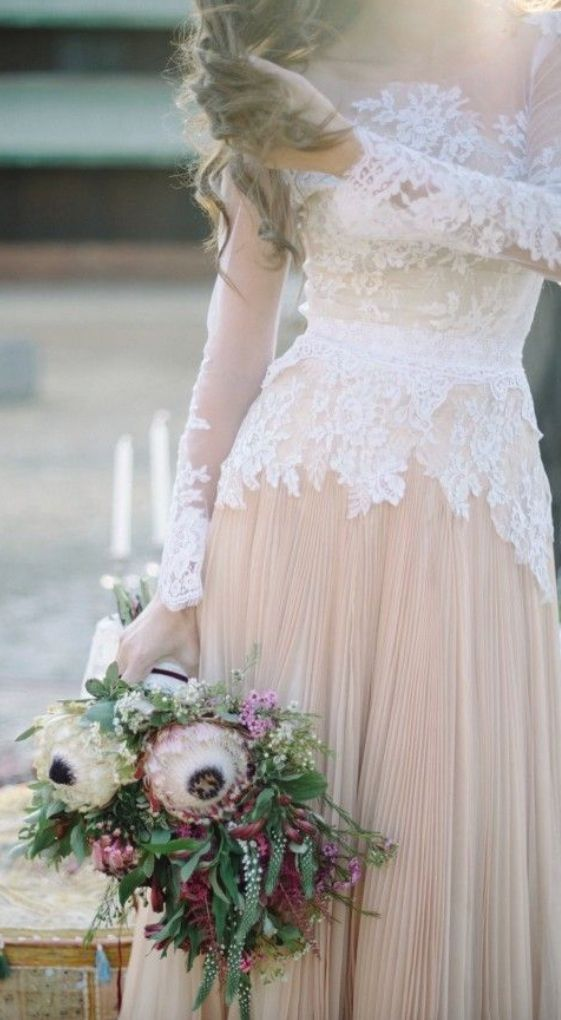 Lovely long-sleeve lace overlay wedding dress; Featured Photographer: Laura-Leigh