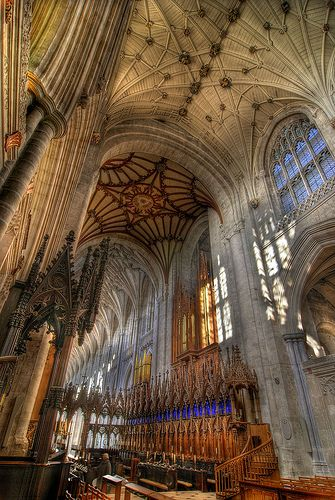Winchester in Hampshire, UK. This is the view from the High Altar through the Choir Stalls to the longest cathedral Nave in Europe. The figure standing in the choir stall area gives the sense of sheer size of the building.