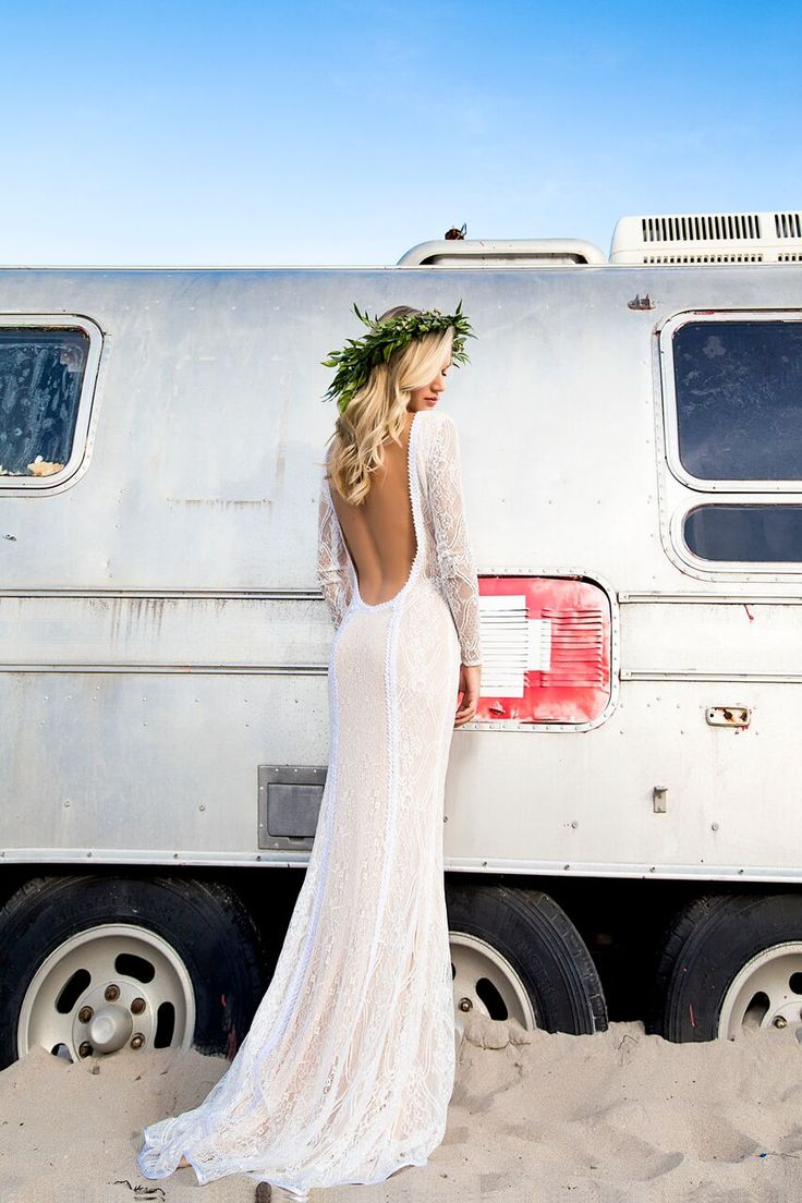 Boho chic bride in this dramatic open back lace wedding dress by @islandbridals