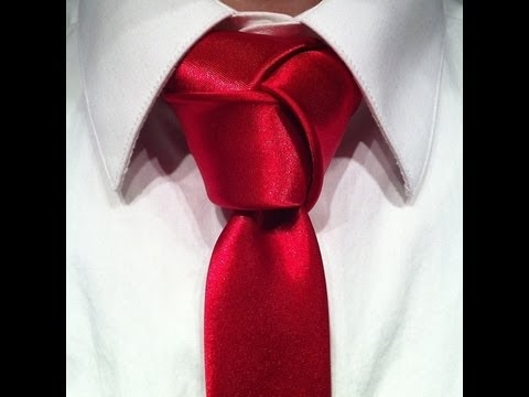 """***Video is mirrored***    Tie sponsored by:  http://ultimatesilktie.com/    Do you ever go into a formal or business casual environment and have someone say """"Wow man, awesome knot, how do you do that?"""" Not wearing that Double Windsor you haven't. Well finally, now that you are able to tie the Trinity knot after watching my handy demonstration, you c..."""