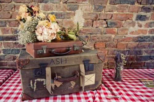 red gingham wedding table cloth and vintage suitcase