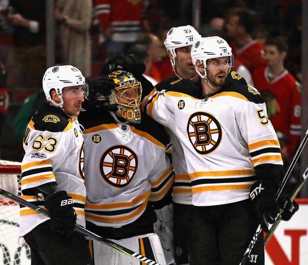 CHICAGO, IL - APRIL 02: (L-R) Brad Marchand #63, Anton Khudobin #35, Adam McQuaid #54 and Zdeno Chara #33 of the Boston Bruins celebrate a win over the Chicago Blackhawks at the United Center on April 2, 2017 in Chicago, Illinois. The Bruins defeated the Blackhawks 3-2. (Photo by Jonathan Daniel/Getty Images)