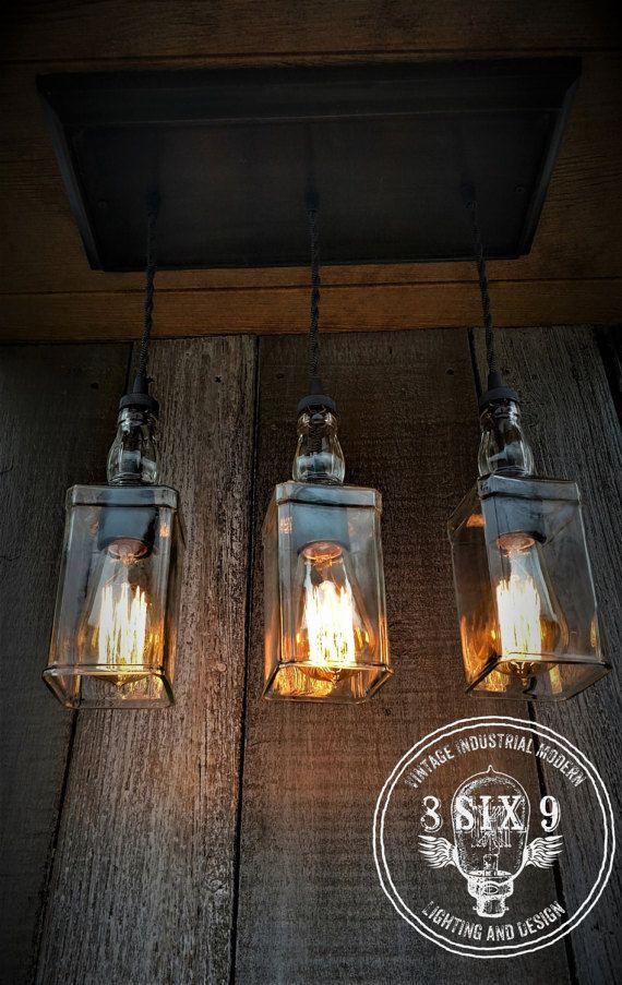 Industrial Triple Whiskey Pendant Lighting with Canopy Edison Lighting Industrial Lighting Whiskey Bottle Lighting Home Decor Upcycled Edison Lighting, Bar Lighting, Lighting Design, Pendant Lighting, Lampe Industrial, Vintage Industrial Lighting, Liquor Bottle Lights, Bottle Chandelier, Bedroom Lamps