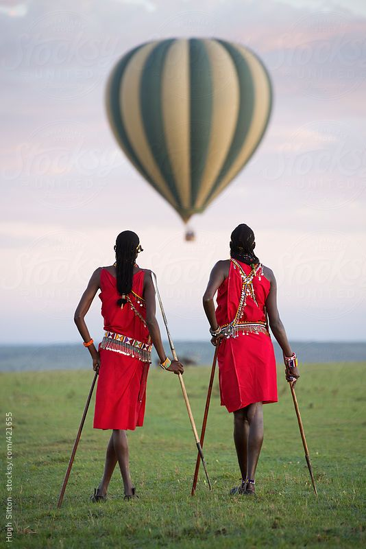 Maasai tribesmen in the Maasai Mara National Park. Kenya. Africa. by Hugh Sitton