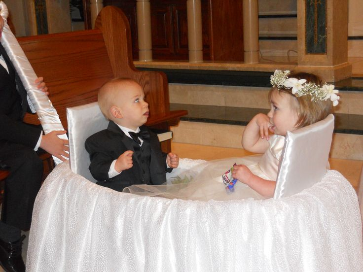 Cover a wagon with white fabric and have someone pull the flower girl and ring bearer down the aisle http://www.weddingboothapp.com/