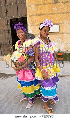 Two Cuban Women In Colorful Dresses Posing For Photo On The Street