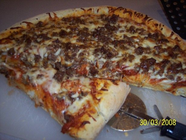 Easy Bread Machine Pizza Crust.  Delicious!!  Dough was so easy to work with, just rolled it out on a big cookie sheet.  Taste was great and baked up nice and crispy in only 10 minutes.