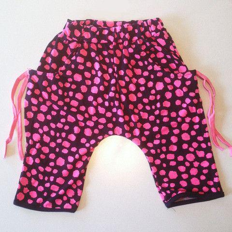 Cheetah pants with decorative drawstring.