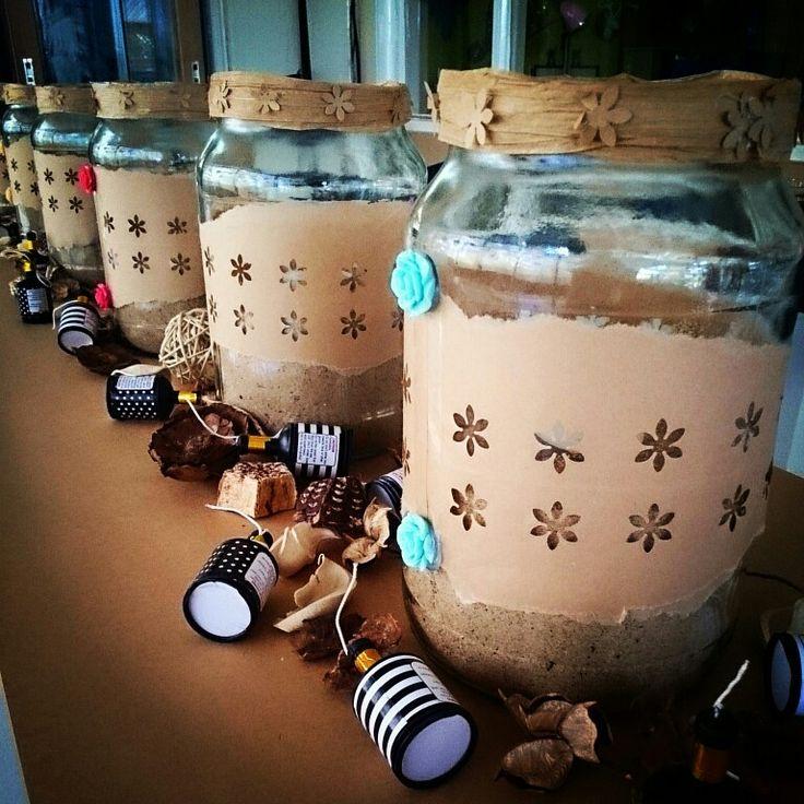 Moccona coffee jars upcycled. Love them, tea lights and sand inside