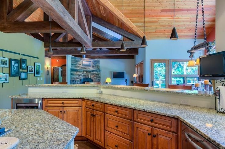 Craftsman Kitchen with U-shaped, Raised panel, Wine refrigerator, slate floors, Kitchen island, Complex granite counters