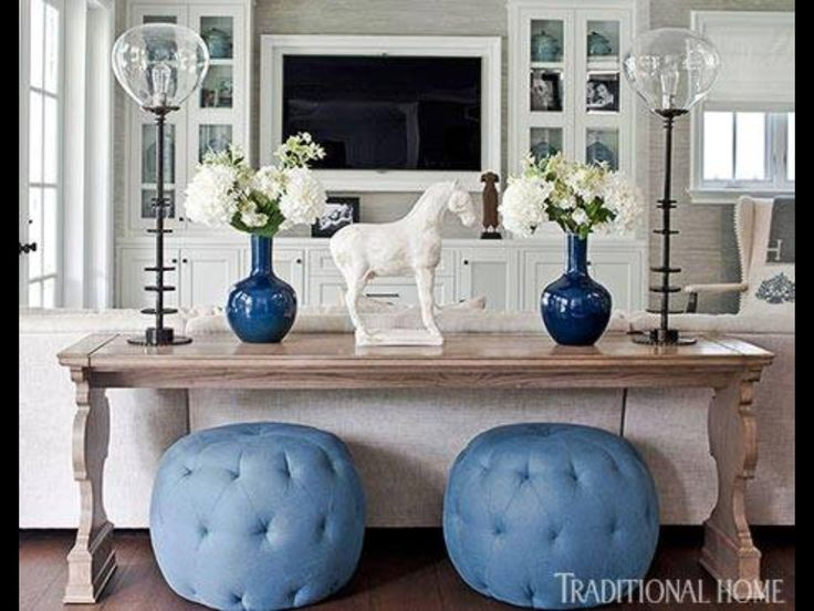 Tufted ottomans below table