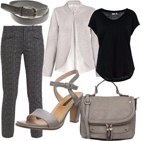 Pantalone stretto a vita bassa in grigio/nero abbinato ad una cinta sottile una t-shirt basic nera ed una giacca senza chiusura sul grigio perla. Sandali con tacco media altezza ed una borsa in pelle sintetica e tracolla regolabile.