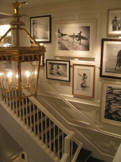 Old sepia and black & white beach pictures in the entry/foyer. Great idea for a beach house.