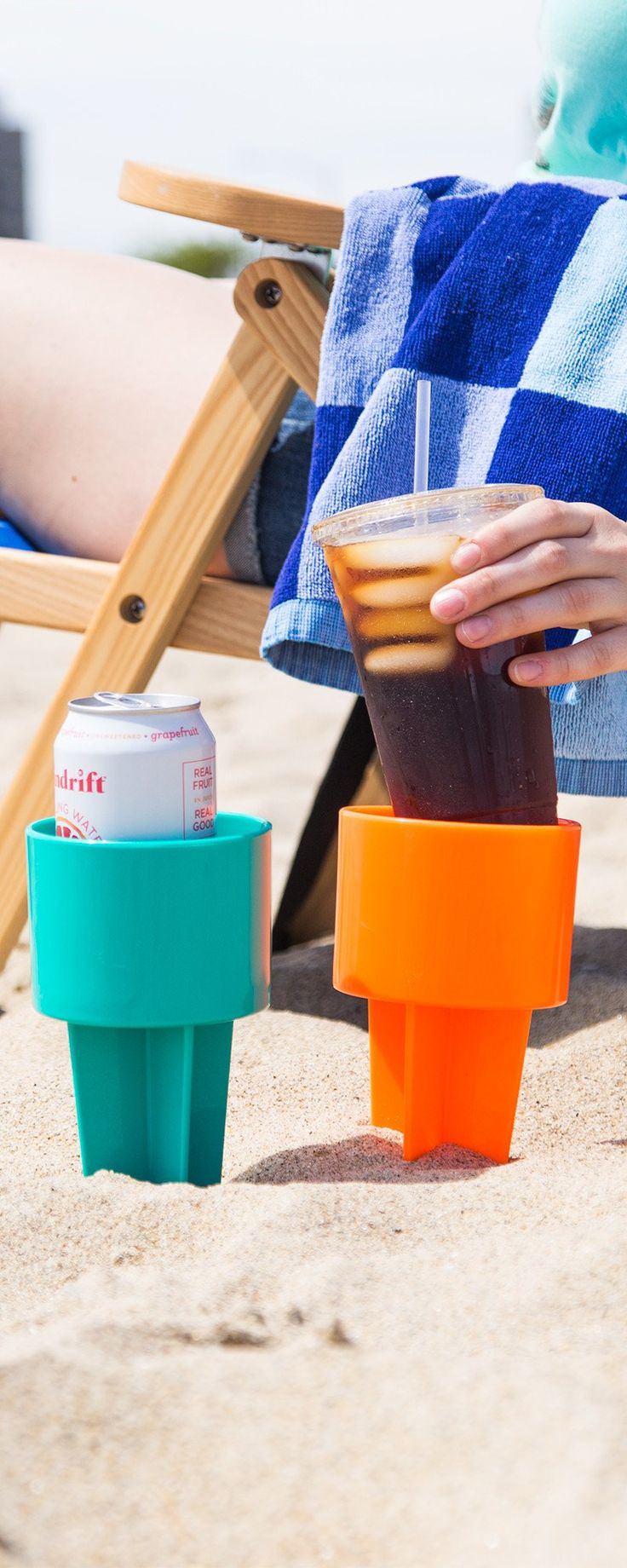 A spill-free, sand-free home for your drinks and essentials at the beach. This cup holder goes into the sand and keeps your drink elevated.