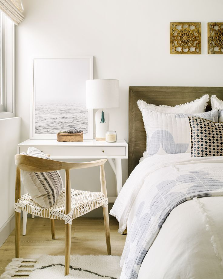 Desk Next To The Bed With Art And A Bedside Lamp How To Style A Bed Woven Desk Chair Boho Girls B Small Guest Bedroom Guest Bedrooms Modern Guest Bedroom