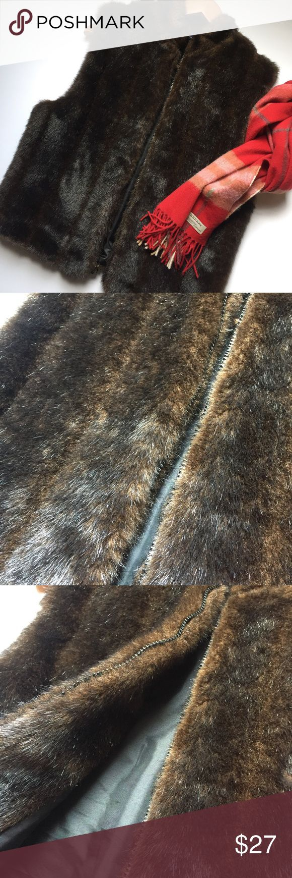 Outstanding Faux Mink Vest Purchased from Dillard's. Worn once! Absolutely flawless. Front zipper and fully lined. Beautiful high quality piece at a low price. Preston & York Jackets & Coats Vests