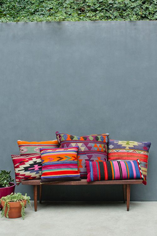 Navajo pillows for a pop of color? Also could be cool for outside hammock/deck furniture