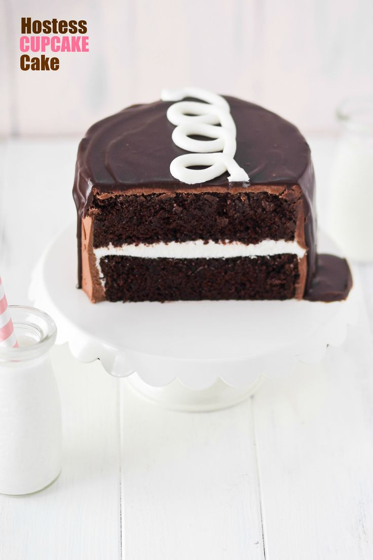 Hostess Cupcake fans will LOVE this Hostess Cupcake Cake filled with cream filling and topped with a signature squiggle!