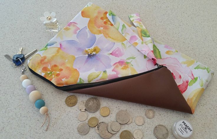 These beautiful large clutches can go with any outfit and are a great everyday clutch - or dressy enough for a night outFeatures33cm boho gold zipperHalf back faux leather on one sideHalf beautiful fabric of choice on other side Fully lined with back fabric $8.50 flate rate shipping Australia wideSize -Width: 34cm Height: 20cm*All Products are Handmade and Designed by myself, they may slightly vary in size and pattern, making each product truely unique.Measurements listed are always the…