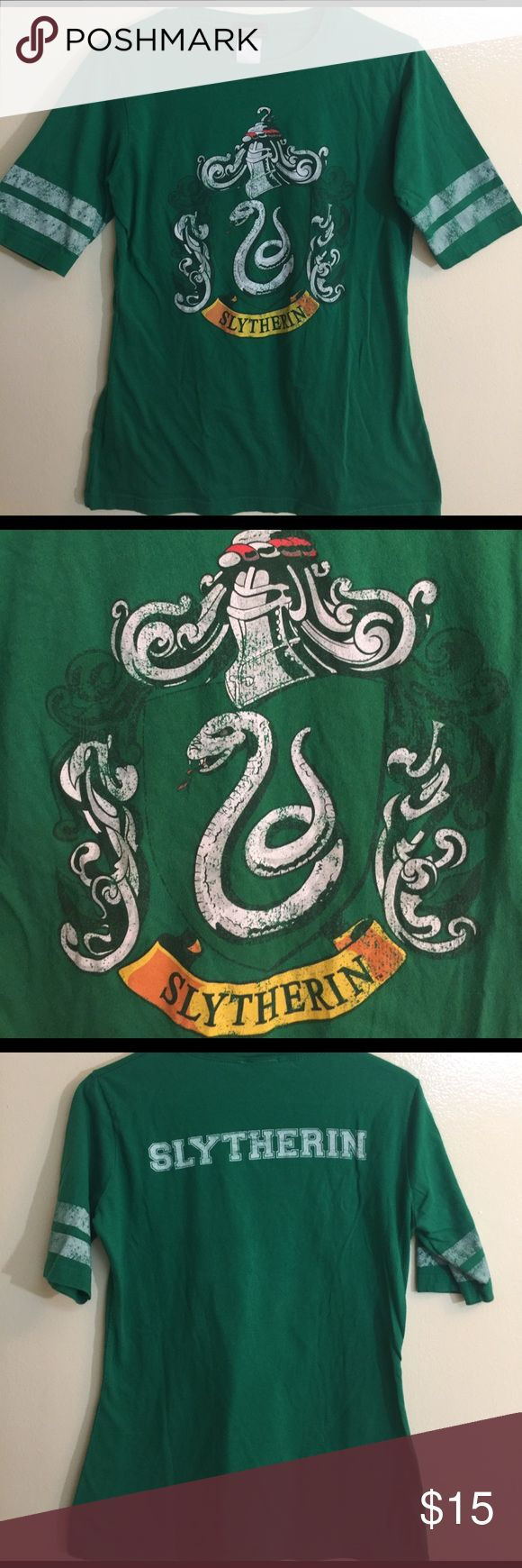 Harry Potter Slytherin Green Women's Tee This is the real deal the Harry Potter Tee you  have been waiting for! It is kelly green and has SLYTHERIN on the back! It is in perfect condition and ready to go! Harry Potter Tops Tees - Short Sleeve