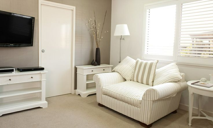 We created a restful reading spot out of an unused space in this master suite.