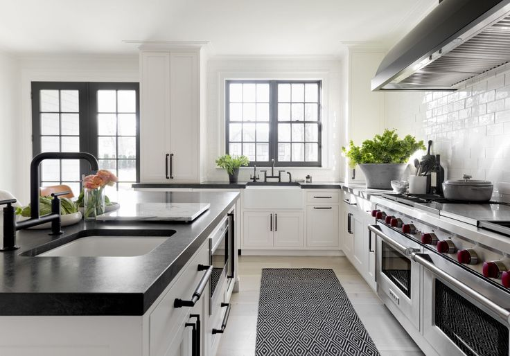 Black countertops, black window trim, white cabinets