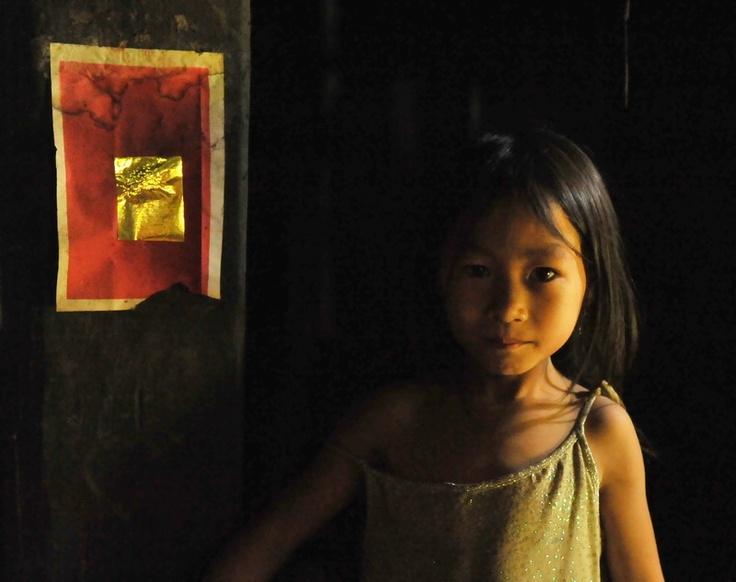 Lovely little Mong Girl in her traditional house.