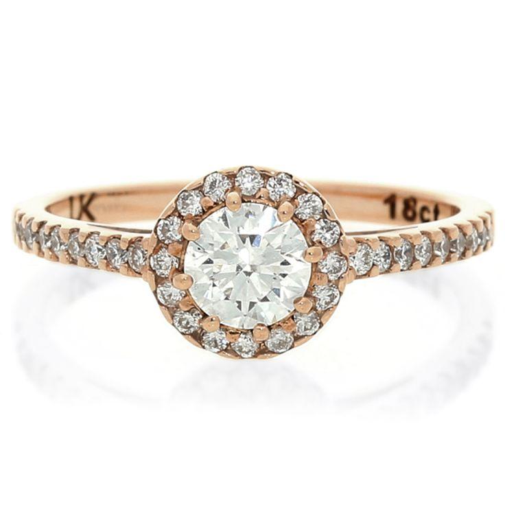 18K Rose Gold Halo Diamond Ring For Sale by Uwe Koetter.    www.uwekoetter.com
