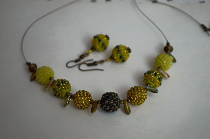 Elegant beaded necklace and earrings by NataliesBijoux on Etsy