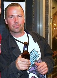 "Doug Stanhope.  Not dead yet, but a Pantheon aspirant.  Stanhope taking no prisoners on over population: ""You could drive an entire fleet of Hummers to and from work everyday, hanging your ass out the window and farting styrofoam packing peanuts into the atmosphere, and still not cause the fraction of the damage one stupid baby causes to this planet."""