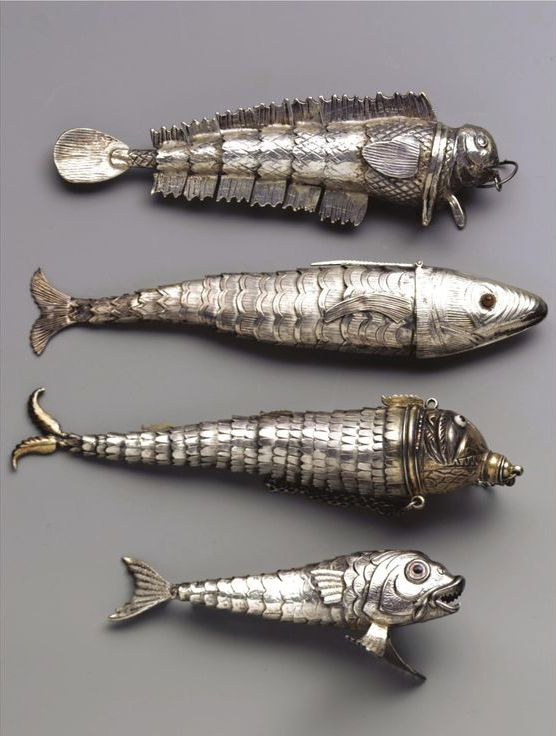 articulated silver fish pendants. i have one of these, apparently theres a (german) tradition when a girl turns 14 years and 7 weeks she gets a necklace with one of these on it.