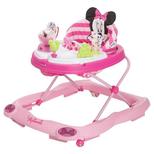 The Disney Baby Minnie Mouse Music & Lights Walker offers plenty of fun for your little one. The oversized play tray features 4 Minnie Mouse and friends toys and conveniently swings open to reveal a snack tray perfect for little treats or small toys. Sturdy wheels work well on floors and carpet alike, while the grip strips reduce walker movement on uneven surfaces. With a machine-washable padded seat, cleaning the walker is as easy as A-B-C!<br><br>• 2 swing-open acti...