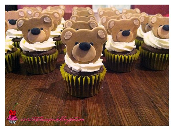 Teddy Bear cupcakes.  I like how the eyes are set back.  I want to try this with frosting instead of fondant.
