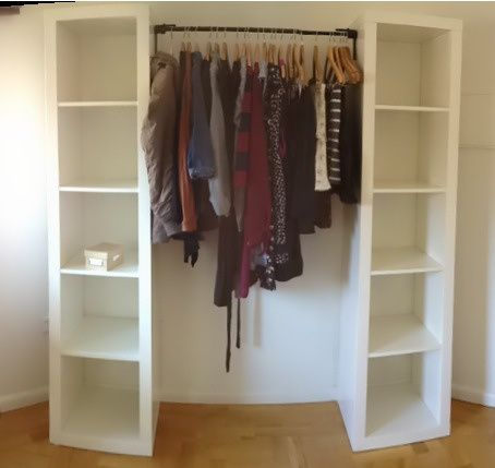 DIY Wardrobe - could put a curtain pole across to connect shelving units and save finding doors too!