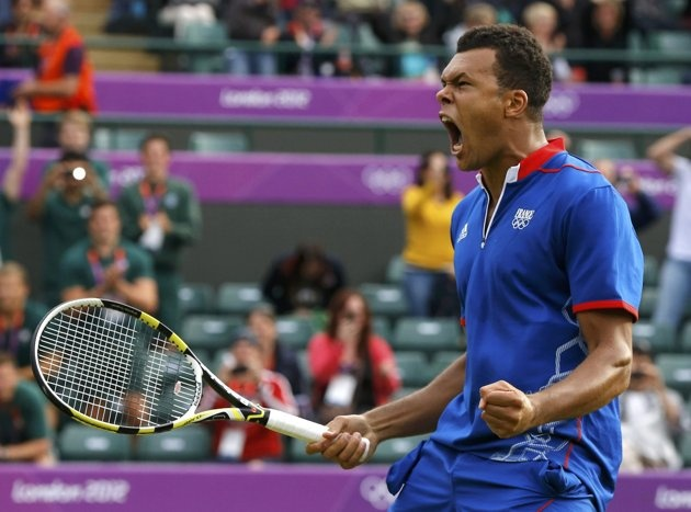 France's Jo-Wilfried Tsonga celebrates after defeating Canada's Milos Raonic in their men's singles tennis match at the All England Lawn Tennis Club during the London 2012 Olympic Games July 31, 2012. Tsonga prevailed after winning the third set 25-23. REUTERS/Phil Noble (BRITAIN - Tags: OLYMPICS SPORT TENNIS TPX IMAGES OF THE DAY)