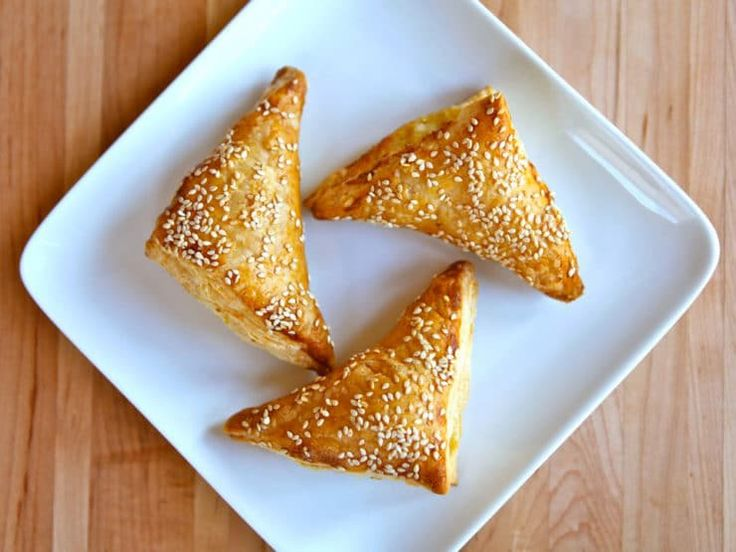 Cheese Bourekas - Recipe for savory Cheese Bourekas filled with creamy and salty feta cheese, kashkaval, & ricotta. Kosher, dairy.
