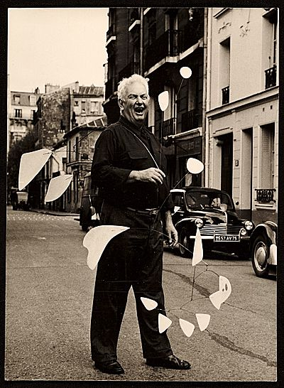 Citation: Alexander Calder holding his mobile on a Parisian street, 1954 / Agnès Varda, photographer.: