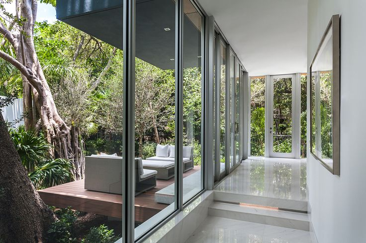 Thanks to floor-to-ceiling glass, the home feels like it's part of the landscape.