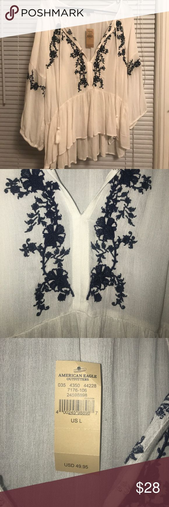 Never worn American Eagle shirt This is a beautiful top! Never worn, no flaws!! Navy blue embroidery :-) American Eagle Outfitters Tops Blouses