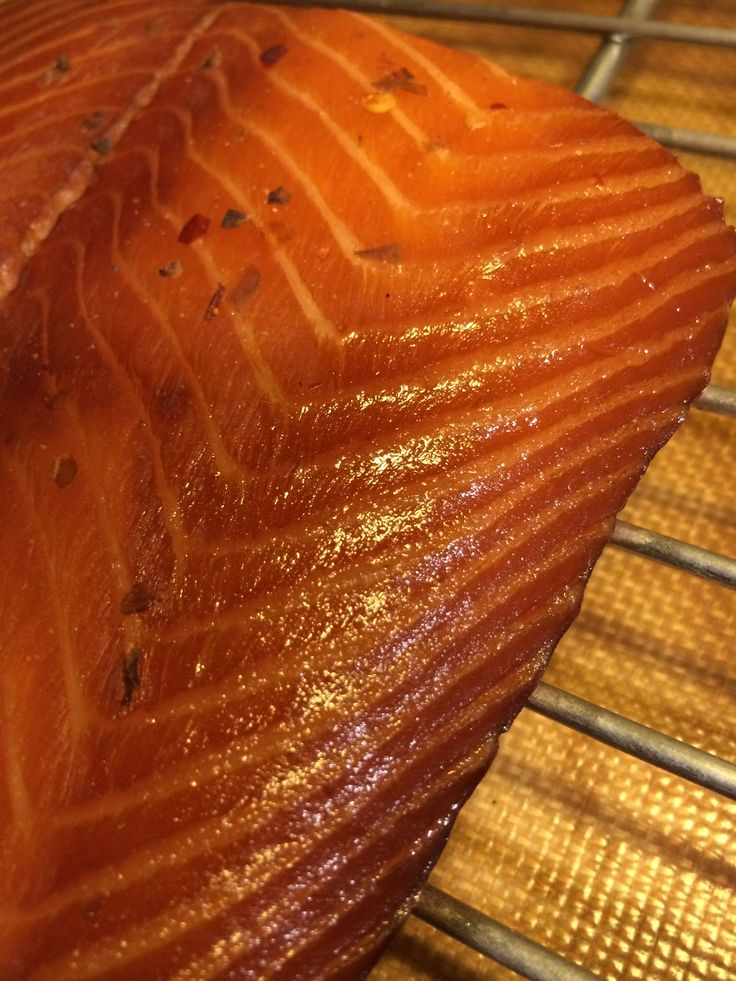 This Smoked Salmon Brine recipe calls for sugar, salt, soy sauce, water, white wine and other spices to cover and sit overnight then air dry to create a